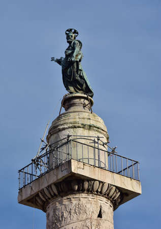 key of paradise: Bronze statue of Sain Peter at the top of Trajan Column in Imperial Forum, Rome Stock Photo