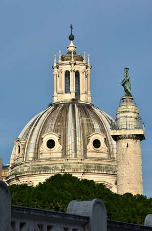 patron of europe: Church of the most holy name of Mary beautiful dome and Column of Trajan with Saint Peter statue viewed from Vittoriano terraces