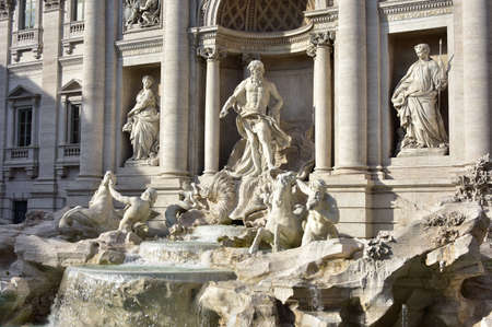 deities: Beautiful baroque Trevi Fountain with ocean deities marble statues Stock Photo