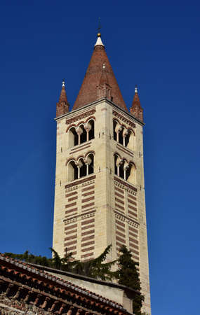 patron of europe: San Zeno belfry in Verona with its typical conical spire Stock Photo