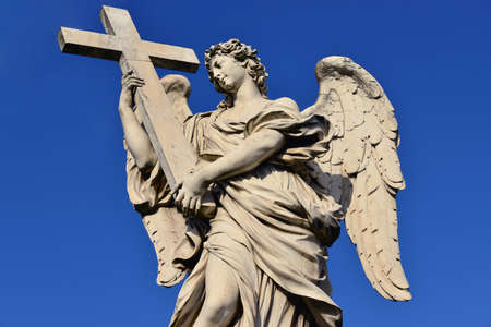 Beautiful marble angel with the Holy Cross from Ponte SantAngelo bridge, in the center of Rome