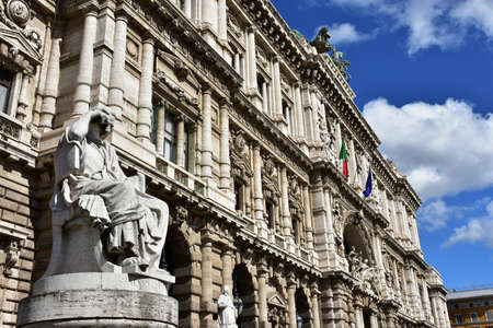 govern: Incredible monumental facade of the Old Palace of Justice in Rome, built in the 19th century, with statue of an ancient roman senator