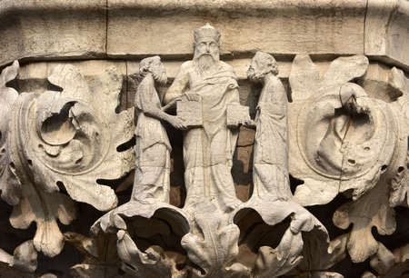 saint mark square: Medieval relief from Doge Palace in Saint Mark Square with the great greek philosopher Aristotle with His disciples Editorial