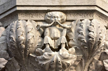 luxuriant: Medieval relief from Doge Palace in Saint Mark Square with a man blowing into two horns among luxuriant plants symbolizes the month of March and spring