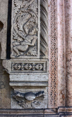 14th century: Detail of a man entangled among plants from a relief in San Fermo Maggiore church gothic portal (14th century)