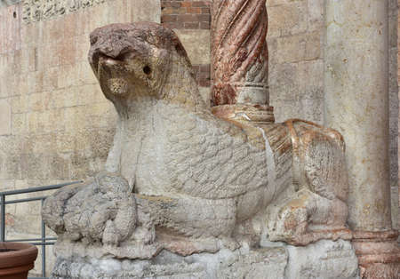 12th century: Medieval statue of a griffin holding a little dragon, from Verona Cathedral beautiful romanesque portal (12th century)