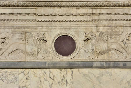 polychrome: Detail of Scuola Grande di San Marco renaissance facade in Venice, with two relief of griffins and decorations (now the entrance of Venice main hospital)