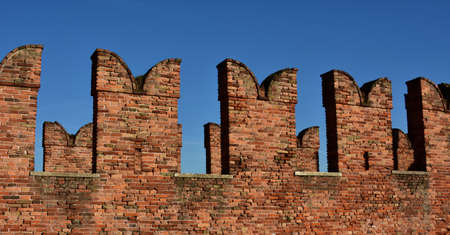 embrasure: Typical Ghibelline battlement merlons and from medieval Scaliger Bridge in Verona Stock Photo