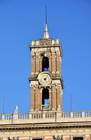 minerva: Reinassance Bell Tower at the top of Capitoline Hill in Rome, designed by Martino Longhi in the 16th century, with Minerva statue and papal coat of arms
