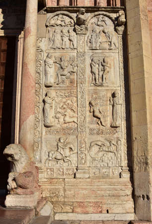 12th century: Detail from the romanesque San Zeno Basilica portal in Verona with relief of religious and medieval scenes (12th century)