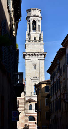 16th century: White marble Verona Cathedral (Duomo) belfry, designed by italian renaissance architect Sanmicheli in the 16th century, seen from historical center narrow street.