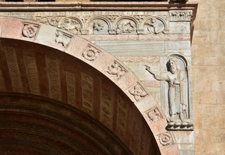 lamb of god: Detail from Verona Cathedral old romanesque porch with relief of John the Baptist and the inscription: Ecce Agnus Dei (this is the Lamb of God) Stock Photo