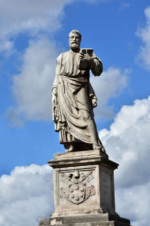 keys to heaven: Marble statue of Saint Peter, patron of Rome, at the entrance of SantAngelo monumental bridge, created by sculptor Lorenzetto in the 16th century