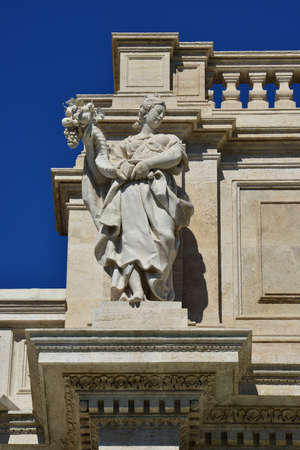 allegoric: Allegorical marble statue symbolizing the abundance of fruits, from the attic of the wonderful Trevi Fountain in the center of Rome (18th century) Stock Photo