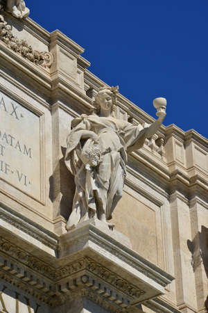 allegoric: Allegorical marble statue symbolizing the products of autumn, from the attic of the wonderful Trevi Fountain in the center of Rome (18th century)