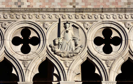 saint mark square: Goddess of Justice among lions relief, from Venice Doges Palace facace in Saint Mark Square Editorial
