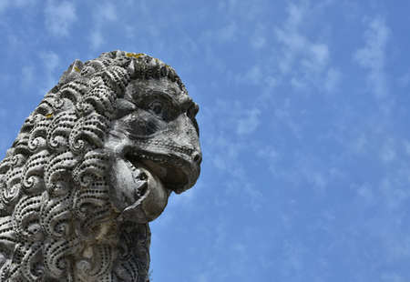 ancient lion: Detail of an ancient lion statue, in the Lucca medieval walls gardens
