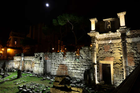frieze: View of the Forum of Nerva at night and the famous Colonnacce with frieze about the myth of Minerva and Archne