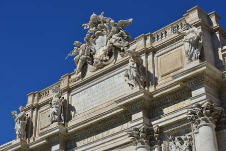 angels fountain: Beautiful attic of Trevi Fountain with Pope emblem among angels and allegoric statues