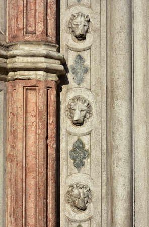 saint mark square: Detail of three saint mark lions decoration from Porta della Carta gothic portal in Saint Mark Square, Venice