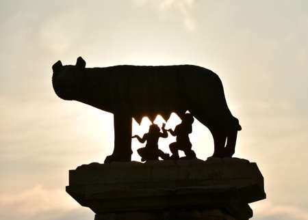 founding: Dawn on Rome, the founding of the city. Capitoline Wolf bronze statue with roman twins Romulus and Remus silhouette shoot at dawn on Capitoline Hill, in the center of Rome