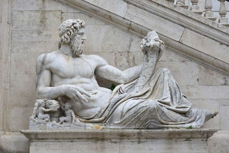 Ancient marble statue of River Tiber god protects Romulus and Remus With His right arm, from Capitoline Hill Square, in the center of Rome
