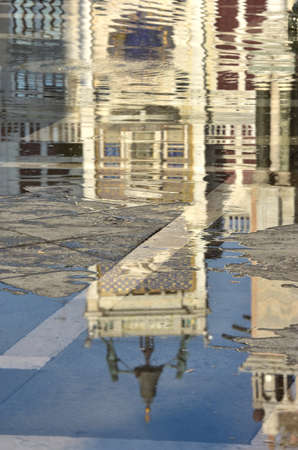 high tide: Saint Mark Clock Tower reflection during high tide in Venice Stock Photo