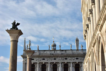 winged lion: Saint Mark square with winged lion column, doge palace arcades and old library at sunset