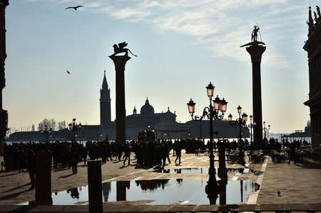 saint mark square: Venice, Italy, November 28, 2015: Saint Mark Square just after high tide, with Saint Georges Basilica and Venice lagoon in the background