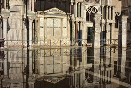 polychrome: Saint Mark Basilica southern facade reflection during Venice high tide, with its ancient polychrome marbles