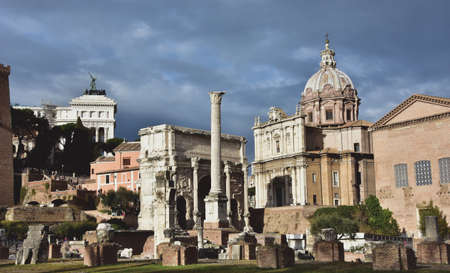 severus: Rome, Italy, January 3, 2016: View of the Roman Forum with the Arch of Septimius Severus, the Curia Julia, Column of Phocas and Saint Luke and Martina church, During a cloudy day