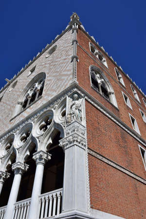 Doges Palace in Venice two different facades with white stone and red brick