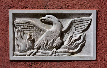 theatre symbol: Old Patera (Venice public art) with phoenix theatre symbol on a wall near the famous opera house