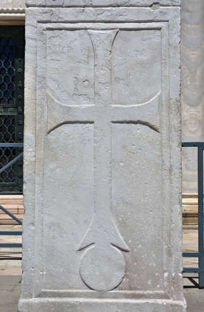 saint mark square: Ancient relief of a cross on Pillars of Acre, in Saint Mark Square, Venice