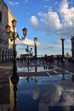 saint mark square: Venice, Italy, June 17, 2016: Saint Mark Square at sunset with hig tide and beautiful clouds