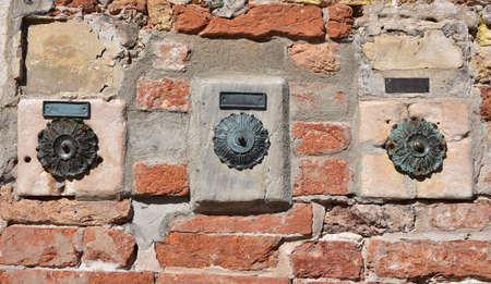 characteristic: Characteristic three old door bell in Venice Stock Photo