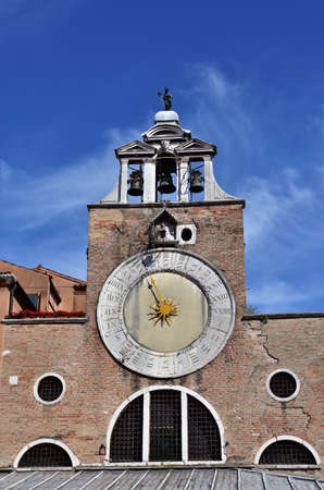 san giacomo: San Giacomo di Rialto ancient medieval clock and bell tower, in the market square, the oldest church in Venice Stock Photo