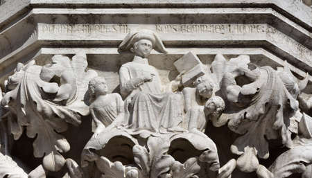 saint mark square: Planet Mercury allegory with Gemini and Virgo signs as teacher and students, from Doge Palace ancient medieval capital in Saint Mark Square, Venice Editorial