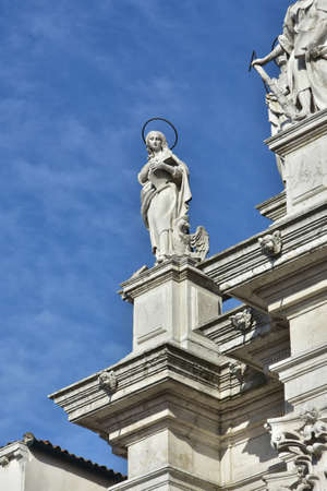 evangelist: Statue of John the Evangelist and Apostle from baroque facade o Santa Maria Assunta jesuit church in Venice (18th century)