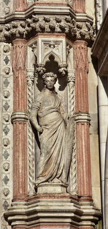 by virtue: Fortitude virtue allegorical statues from Porta della Carta gothic gate in Saint Mark Square