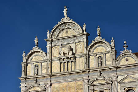 polychrome: Scuola Grande di San Marco beautiful renaissance monument in Venice with statues and polychrome marbles, built in the 16th century (now the city hospital entrance)