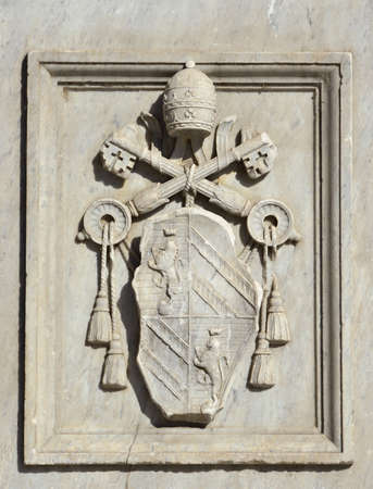 pius: Relief of Pope Pius IX emblem on a monument erected in Tiberina Island (Rome) and made by sculptor Jacometti in 1869
