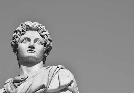 b w: Castor or Pollux with copy space (B  W). Ancient marble statue of Dioskouri at the top of monumental balustrade on Capitoline Hill, Rome