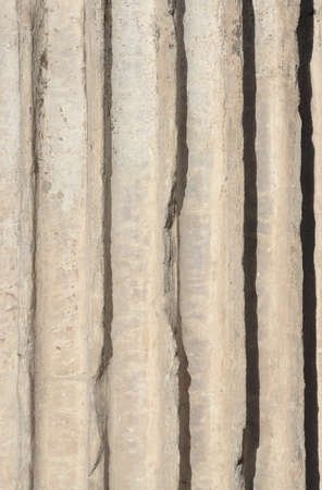 fluting: Detail of an ancient marble column in the Imperial Forum, with fluting and arris as background