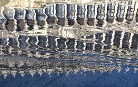 vecchie: Reflection of Procuratie Vecchie in Saint Mark Square during Acqua Alta (Venice high tide)