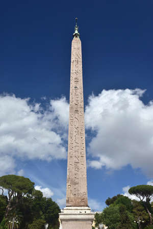 obelisk stone: Ancient egyptian obelisk built during pharaoh Ramesses II reign and brought to Rome by emperor Augustus, now in the center of Piazza del Popolo square Stock Photo