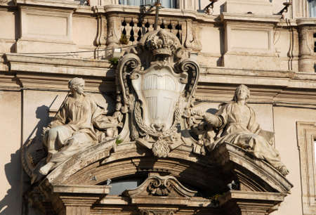 familiy: King of Italy (Savoy Familiy) emblem between vitues Religion and Justice in Quirinale Square in Rome, made by artist Francesco Maini in the 19th century