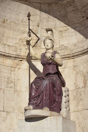 minerva: Ancient marble and porphyry statue of Minerva as Goddess Roma with lance and globe in Capitol Square, Rome