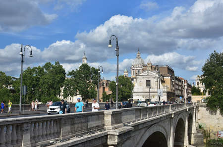 Rome, Italy, May 30, 2016: People and cars cross Ponte Cavour bridge, in the center of Rome