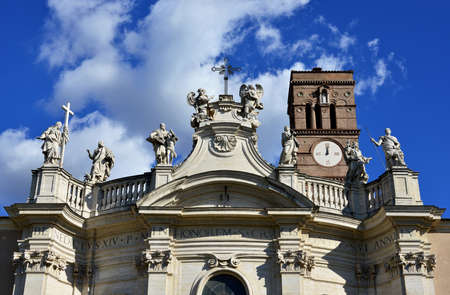 Holy Cross in Jerusalem church with baroque statue of saints and beautiful clouds, in Rome (18th century)